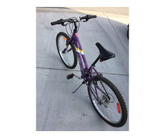 Barely used youth purple bicycle